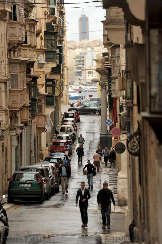 The Portomaso Tower dominates the background in this Valletta street on November 16. Photo: Chris Sant Fournier