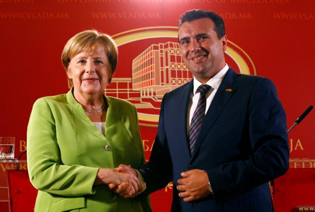 Macedonian Prime Minister Zoran Zaev and German Chancellor Angela Merkel shake hands after a news conference in Skopje.