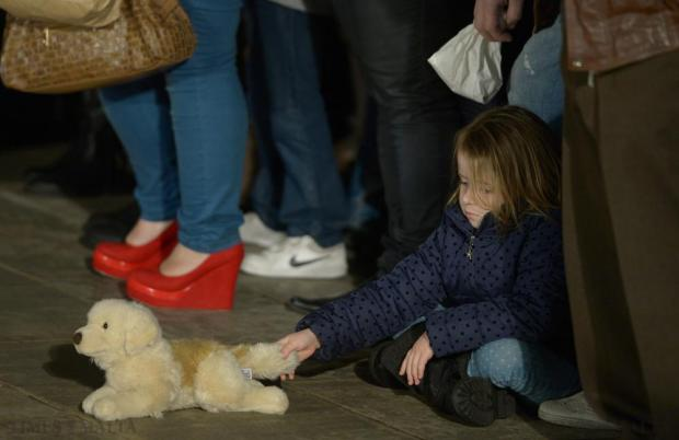 A young girl plays with her toy dog at the launch of the Millied Flimkien Campaign in La Vallette Square in Valletta on December 19. Photo: Matthew Mirabelli
