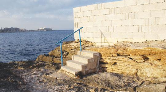 A seven-course perimeter wall around the waterpolo pitch at Exiles has drastically altered public access along the Sliema coastline.