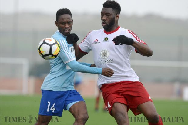 Sliema Wanderers Frank Temile (left) and Lija Athletic's Ousmane Sidibe, during their BOV Premier League match at the Centenary Football Stadium in Ta'Qali on February 3. Photo: Matthew Mirabelli