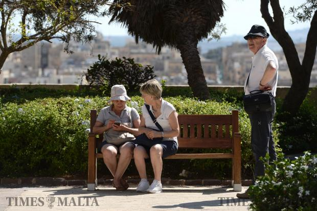 Tourists sit on a bench at the Upper Barrakka Gardens in Valletta on June 16. Photo: Matthew Mirabelli