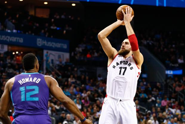 Toronto Raptors center Jonas Valanciunas (17) shoots the ball against Charlotte Hornets center Dwight Howard (12) in the first half at Spectrum Center. Photo Credit: Jeremy Brevard-USA TODAY Sports