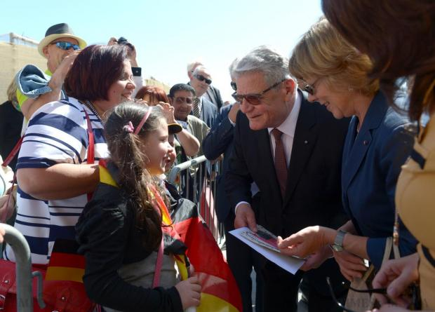 German President Joachim Gauck (centre) and his partner Daniela Schadt (2nd right), are greeted by well-wishers as they are taken on a tour around Valletta by Malta's Prime Minister Joseph Muscat (hidden) and his wife Michelle Muscat (right), on April 30. Photo: Matthew Mirabelli