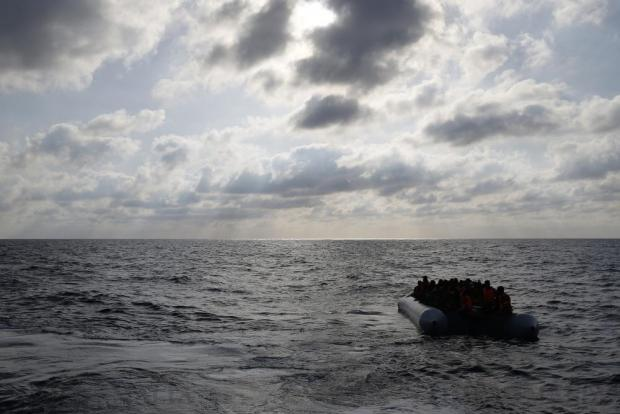 Migrants in a dinghy await rescue by the Migrant Offshore Aid Station (MOAS) around 20 nautical miles off the coast of Libya on June 23. Some 5,000 migrants from over 40 boats were rescued that day, according to the Italian Coast Guard. Photo: Darrin Zammit Lupi