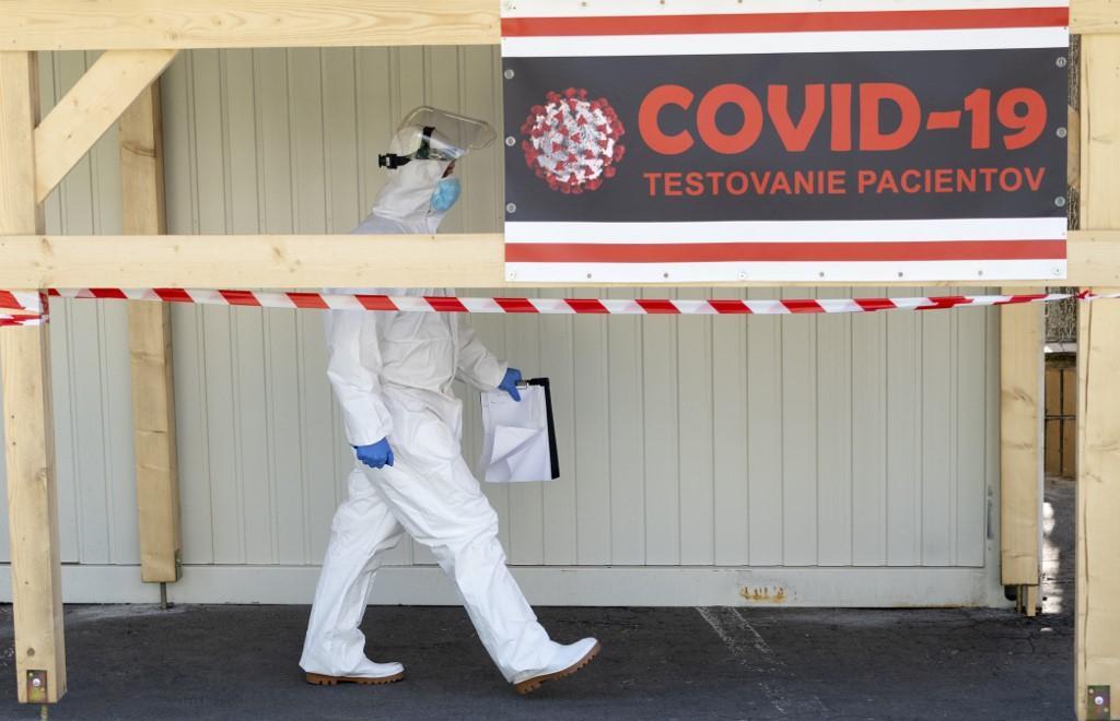 A medical worker walks at a testing centre outside the Kramare University hospital in Bratislava. Photo: AFP