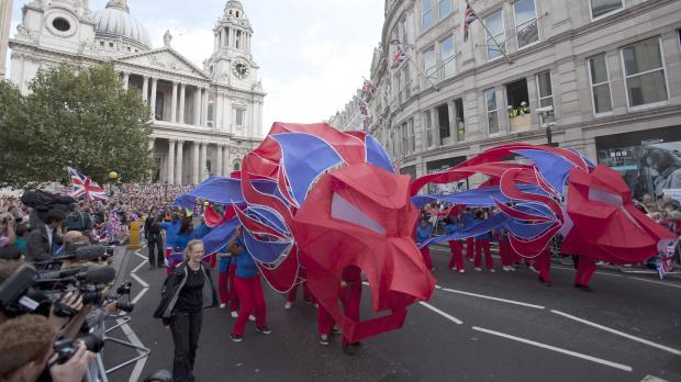 The Olympic and Paralympic 2012 athletes parade passes St Pauls Cathedral