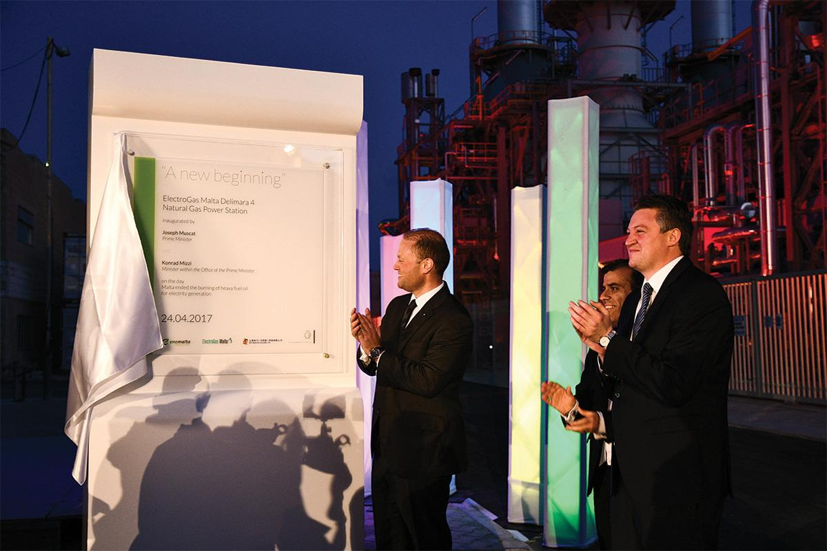 Joseph Muscat and then energy minister Konrad Mizzi applaud the new power station.
