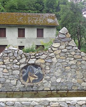 Pyrenean chamois mosaic on a fountain wall near Galey.