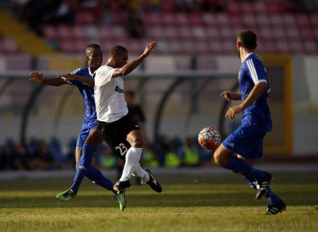 Hibernians' Jorginho (centre) loses possession of the ball under pressure from Mosta's Edile Micheletti (left) during their Premier League football match at the National Stadium in Ta'Qali on October 4. Photo: Darrin Zammit Lupi