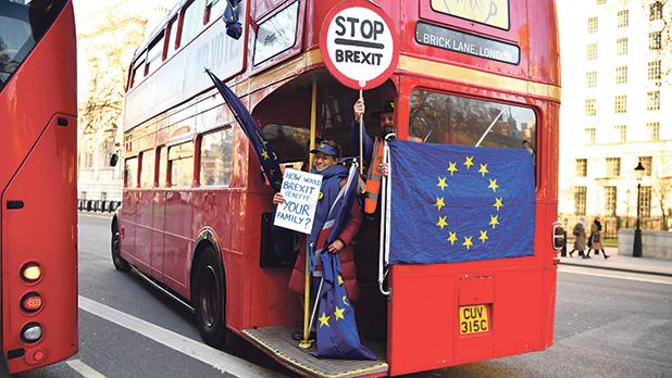 "Anti-Brexit activists hold ""Stop Brexit"" placards at Whitehall, central London, yesterday. Despite the humiliating rejection of Prime Minister Theresa May's Brexit deal, Britain is no closer to knowing the end result of its vote to leave the EU. A raft of amendments to be voted on by MPs today threaten to further muddy the waters as the clock ticks down to Britain's scheduled departure from the EU on March 29. Photo: AFP"