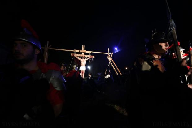 "An actor portraying the crucified Jesus Christ (centre) takes part in the interactive street-theatre performance of ""Il-Mixja"" in the grounds of Mount Carmel Mental Hospital in Attard on March 31. Photo: Darrin Zammit Lupi"