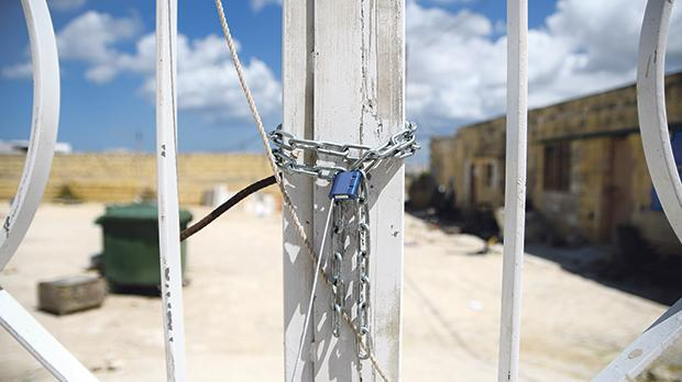 The cow shed used by a group of migrants remains locked after the Planning Authority sanctioned the building. Photo: Jonathan Borg