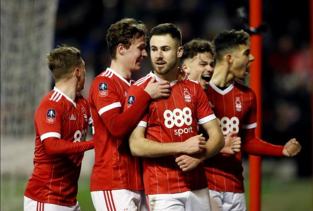 Nottingham Forest's Ben Brereton celebrates scoring their third goal with teammates.