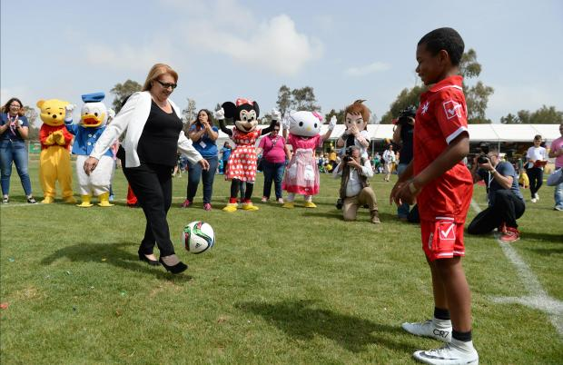 The 60-hour Puttinu Cares football and volleyball marathon is kicked off by Nigel, a young boy who has undergone a heart transplant and President Marie-Louise Coleiro Preca at Marsa on May 18. Photo: Matthew Mirabelli