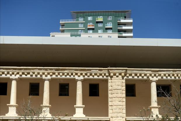 The classic architecture from a section of The Point shopping centre is contrasted against a modern apartment block on the Tigne coast line on March 11. Photo: Matthew Mirabelli