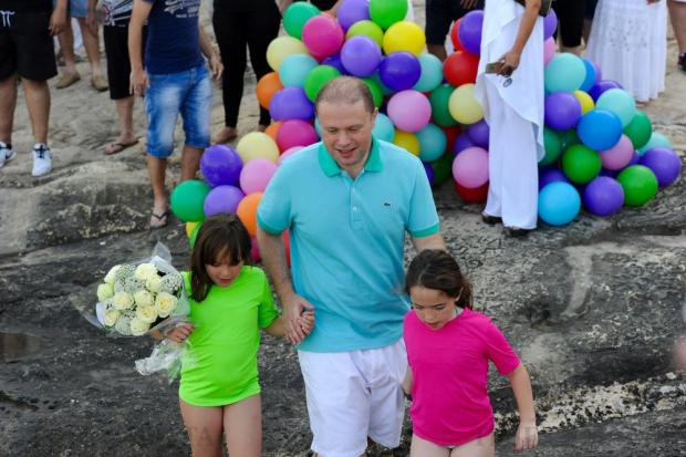 Prime Minister Joseph Muscat and his twin daughters wait for his wife Michelle to arrive in the Grand Harbour, after a three hour long swim for charity on June 25. Photo: Steve Zammit Lupi