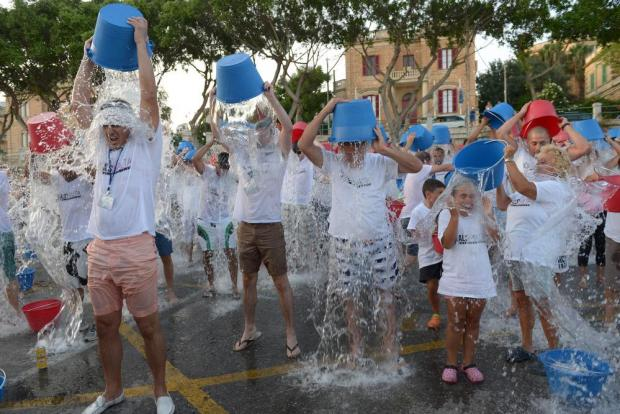 People pour buckets of ice cold water onto themselves during an event organised by ALS Malta and the Ta' Xbiex local council at the yacht marina on August 13. The event raised funds for research into ALS, amyotrophic lateral sclerosis, a progressive neurodegenerative disease that affects nerve cells in the brain and the spinal cord. Photo: Matthew Mirabelli