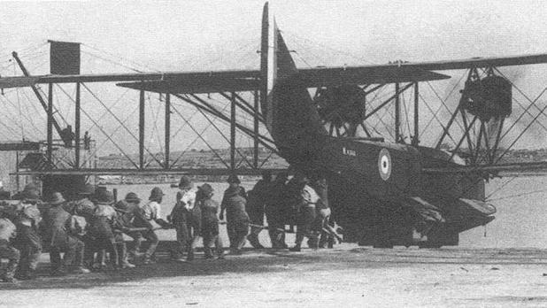 Felixstowe F.3 N4360 is being pulled on the slipway from the sea. This is one of those aircraft built at HM Dockyard.