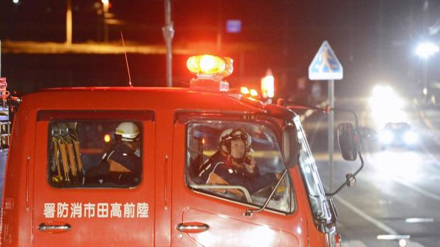 Firefighters in a fire fighting vehicle call for residents to evacuate from coastal areas in Rikuzentakata in Iwate Prefecture.  Photo: Kyodo News