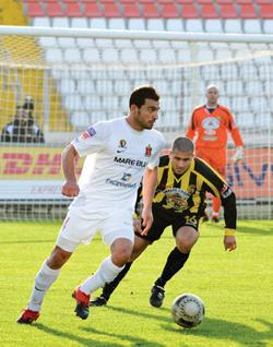 Valletta's Steve Borg moves clear of Qormi striker Ben Camilleri.