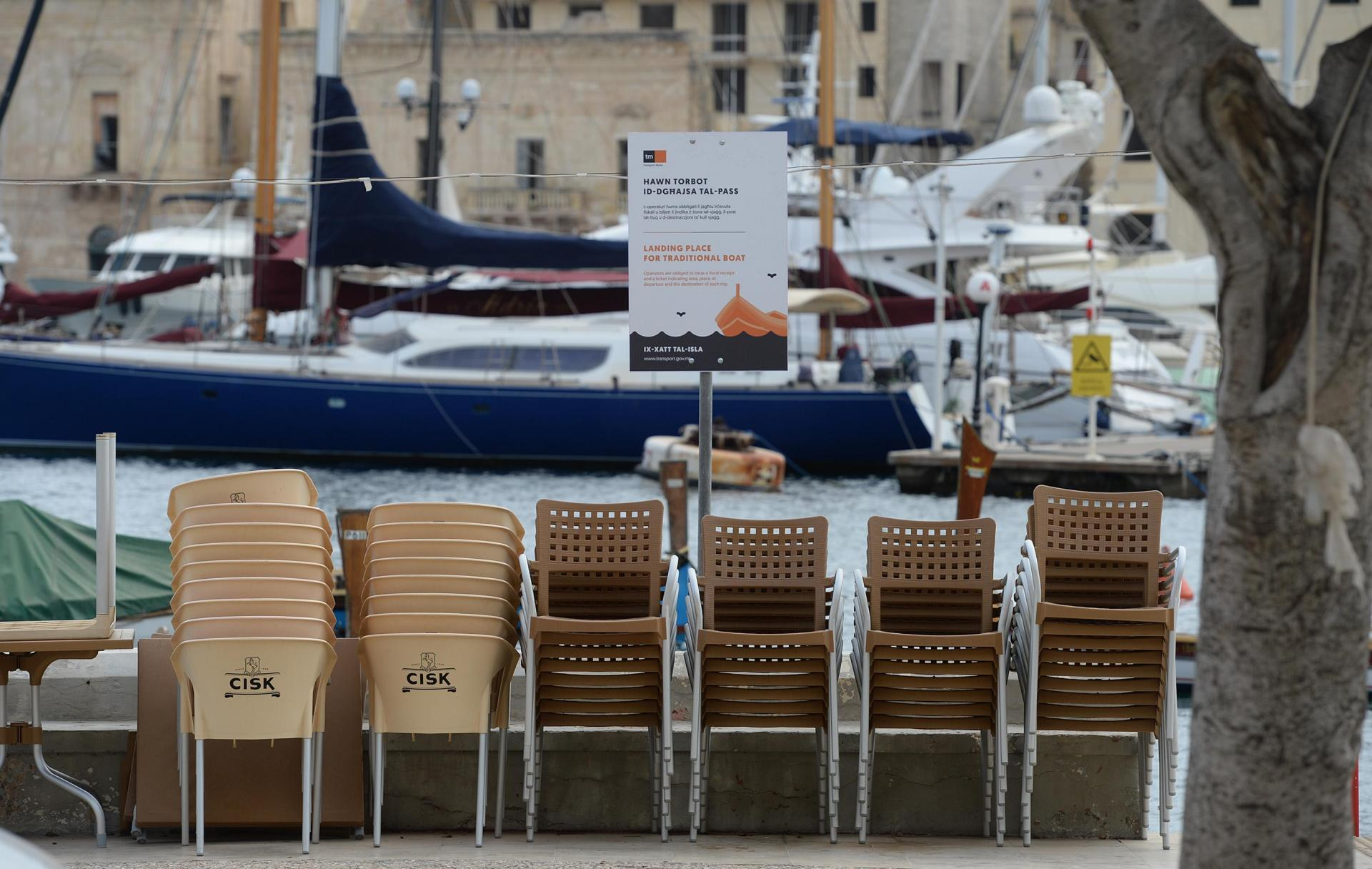 Chairs stacked at closed eateries in Senglea. Photo: Matthew Mirabelli