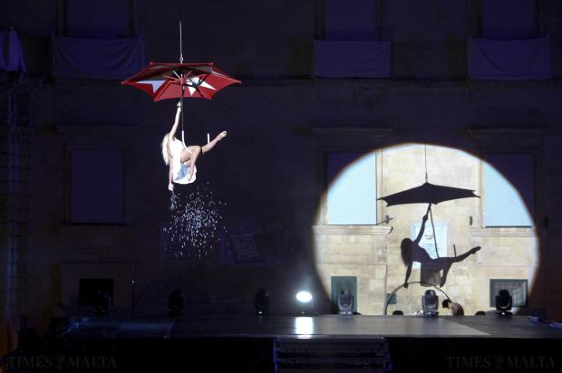 A dancer is suspended from a giant umbrella during the show celebrating the 40th anniversary of Republic Day in Valletta on December 13. Photo: Paul Spiteri Lucas