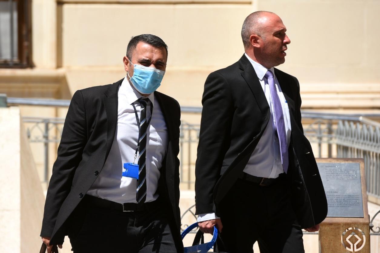 Inspectors Kurt Zahra (left) and Keith Arnaud entering court on Thursday. Photo: Chris Sant Fournier