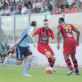 Tight space... Ħamrun forward Daren Falzon tries to find a way past Beppe Muscat, of Sliema Wanderers. Photo:Steve Zammit Lupi