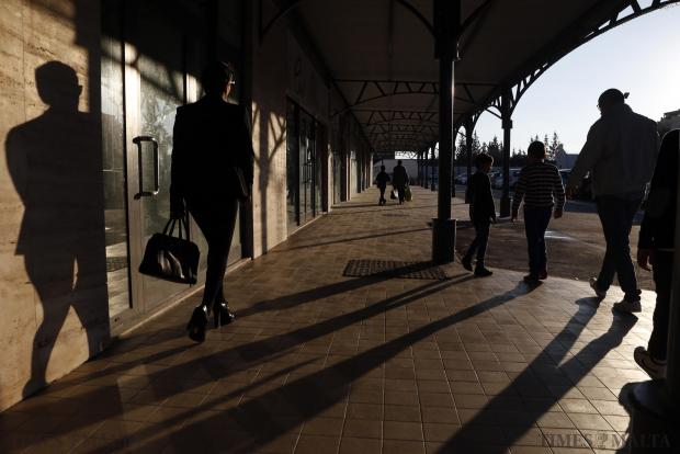 People walk at a shopping mall in Mosta on December 8. Photo: Darrin Zammit Lupi