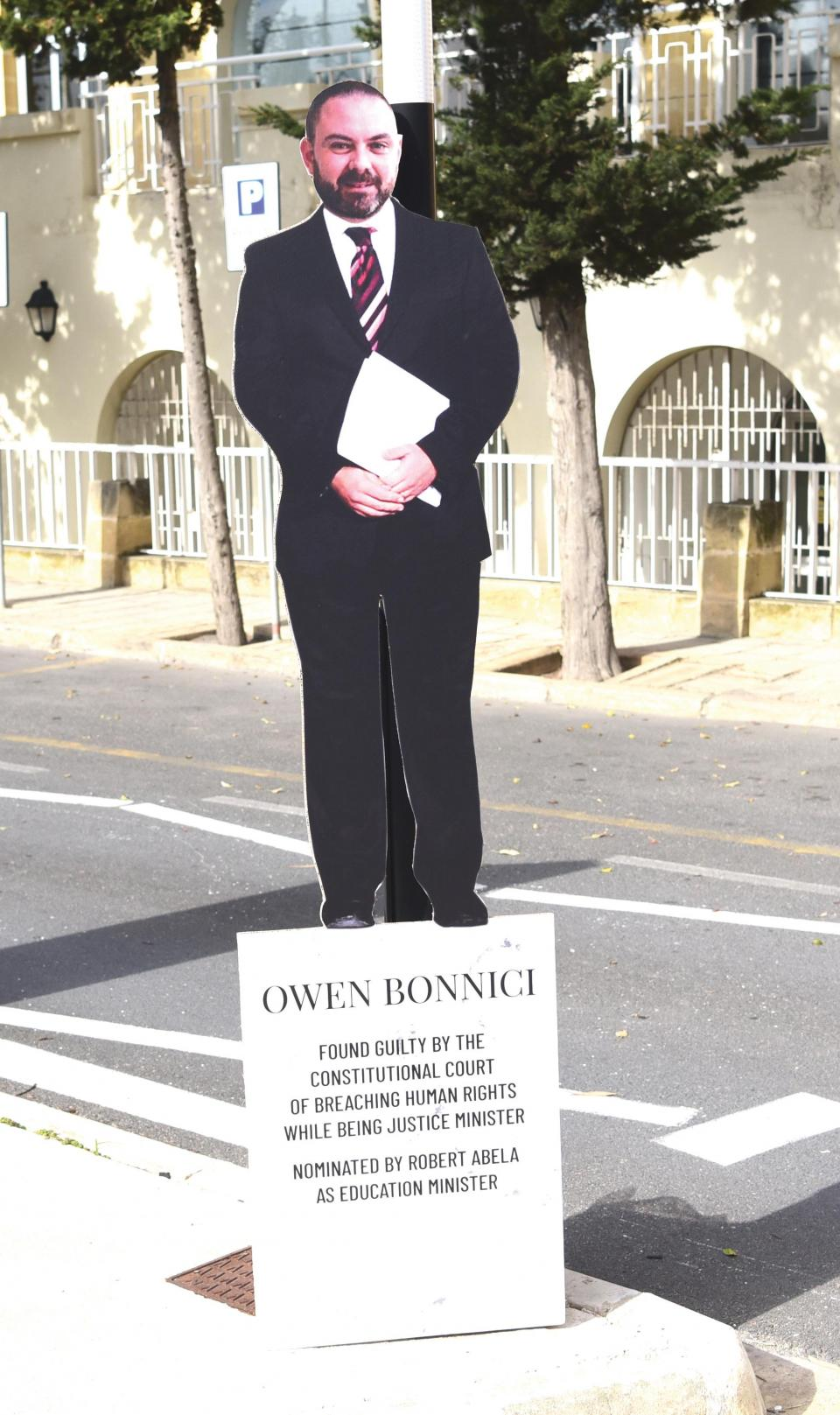 A mock 'monument' saluting for Owen Bonnici in the wake of a court judgment finding him guilty of breaching human rights was erected outside the Education Ministry by rule of law group Repubblika. Photo: Mark Zammit Cordina