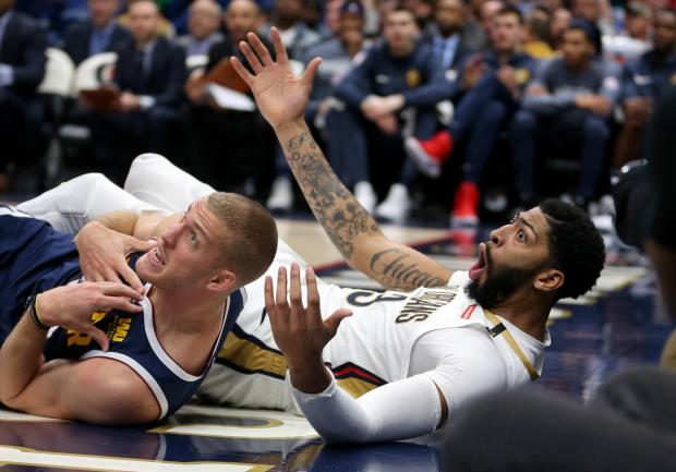 Denver Nuggets forward Mason Plumlee (24) and New Orleans Pelicans forward Anthony Davis (23) wait for a foul call in the second half at the Smoothie King Center. Davis was called for the foul. Mandatory Credit: Chuck Cook-USA TODAY Sports