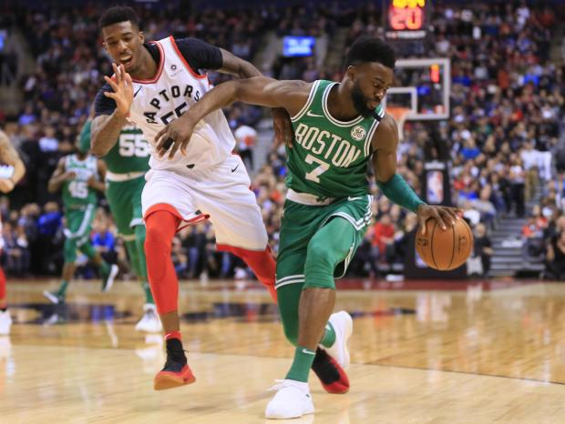 Boston Celtics guard Jaylen Brown (7) dribbles the ball as Toronto Raptors guard Delon Wright (55) defends at the Air Canada Centre. Toronto defeated Boston. Photo Credit: John E. Sokolowski-USA TODAY Sports