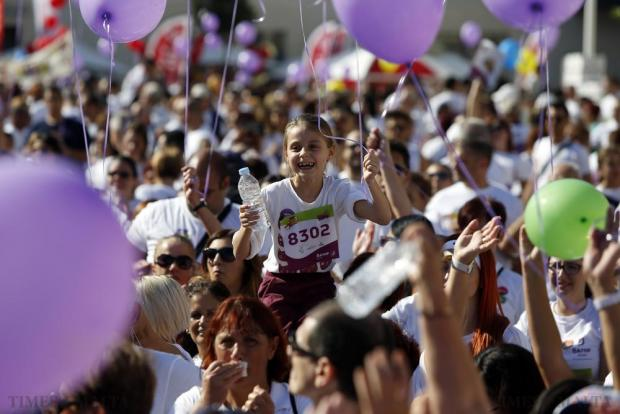 A young participant celebrates at the end of the President's Solidarity Fun Run 2015 at St George's Square in Valletta on November 15. Photo: Darrin Zammit Lupi