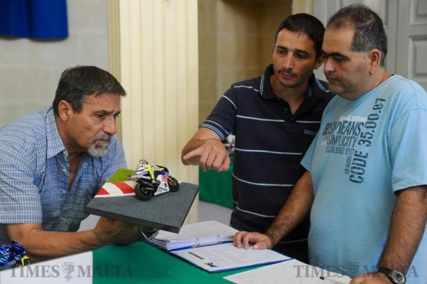 Model exhibitors examine a new hand-built model during the annual model exhibition organized by the Association of Model Engineers in Naxxar on September 30. Photo: Steve Zammit Lupi
