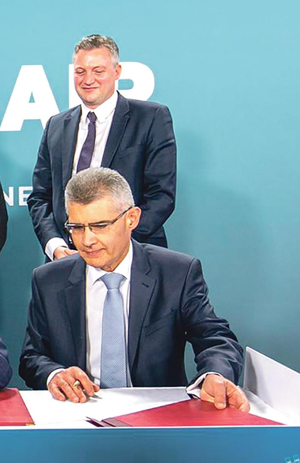 Konrad Mizzi and Malta Air Travel chairman Paul Bugeja.