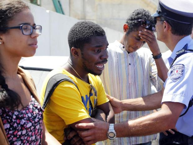 Daboma Jack, a black Hungarian student, reacts after being spat on and slapped by a Maltese woman and then being mistakenly arrested by police, after he tried to instill some order in a chaotic queue at the Valletta bus terminus on July 1. The police apologised for the arrest and an internal investigation into the incident is taking place. Photo: Darrin Zammit Lupi