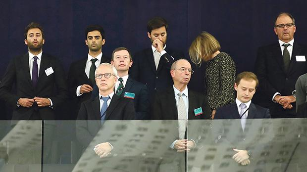 The sons of murdered journalist Daphne Caruana Galizia, Matthew, Paul and Andrew (left to right, back row), and their father, Peter (far right), stand during a minute of silence yesterday at the European Parliament in Strasbourg, France. Photo:Christian Hartmann/Reuters