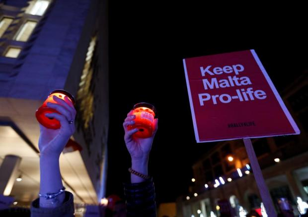 People attend a candlelight vigil organised by the Life Network foundation to reinforce what it described as Malta's traditional and time-honoured values, in Valletta on December 3. Photo: Darrin Zammit Lupi