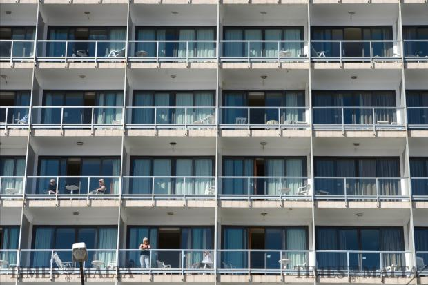 Tourists admire the view from their balconies at the Preluna Hotel in Sliema on February 21. Photo: Matthew Mirabelli