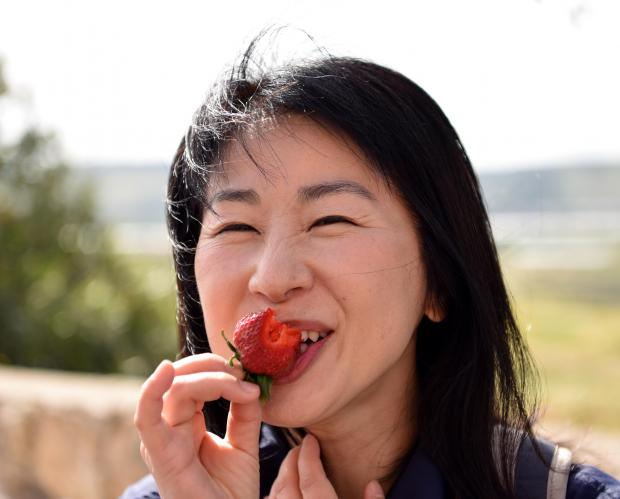 A woman tastes a strawberry during the Strawberry feast in Mgarr on April 08. Photo: Mark Zammit Cordina
