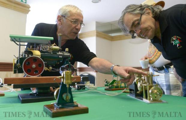 Joe Vella explains the workings of one of his models powered by compressed air. It was among the 500 models on display at a Die-Cast and Scale Model Society exhibition on May 22. Photo: Matthew Mirabelli