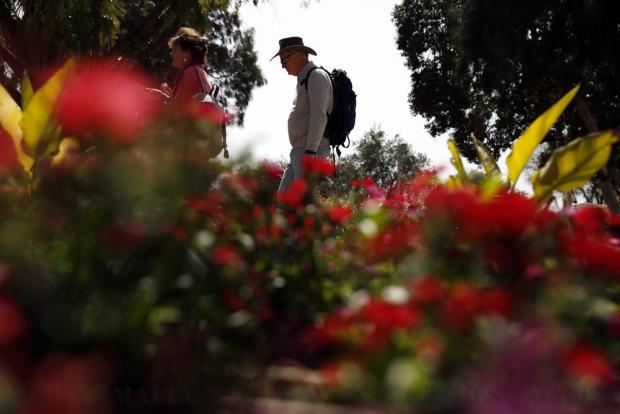 Tourists walk near flower beds on the first day of spring at the Upper Barrakka Gardens in Valletta on March 21. Photo: Darrin Zammit Lupi