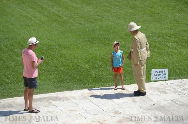 A boy talks with a re-enactor at the Upper Barrakka Gardens in Valletta on August 14. Photo: Matthew Mirabelli