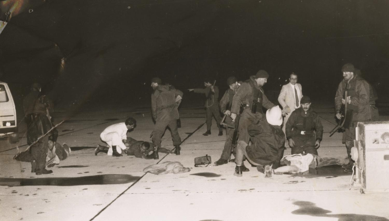Police inspect the passengers after the bloodbath.
