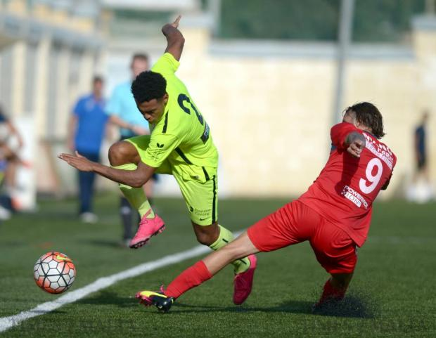 St Andrews' Enmy Manuel Peña Beltre tries to pass Pembroke Athleta's Manolito Micallef at the Tedesco Stadium in Hamrun on October 16. Photo: Matthew Mirabelli