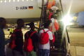 Lifeline migrants leave for Ireland, as others wait for Italy to keep its word