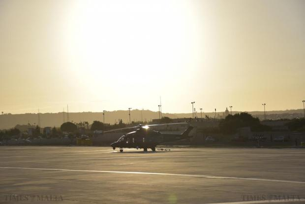 The sun sets behind a helicopter parked at Malta International Airport on September 24. Photo: Mark Zammit Cordina