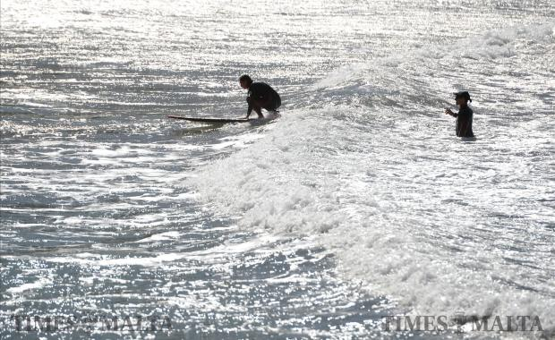 A man learns to surf at Ghajn Tuffieha Bay on February 7. Photo: Matthew Mirabelli