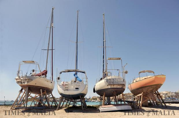 Sailing boats rest on a sand bank for the winter at Marsaxlokk on April 18. Photo: Chris Sant Fournier